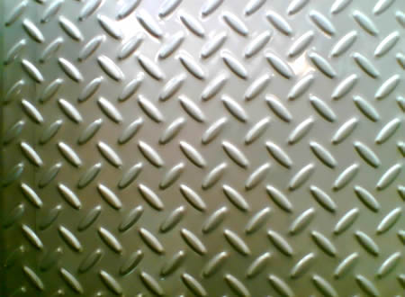 A piece of stainless steel checker plate with big rice projections.